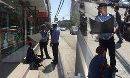 ชาวเน็ตยกนิ้วให้ ตำรวจจีนอย่างหล่อ บังแดดให้ยายหลงทาง