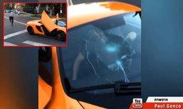 รถหรูไม่จอดให้คนข้าม เจอสเก็ตบอร์ดทุบกระจกร้าว (คลิป)