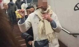 สุดบังเอิญ! สาวจีนจับโจรล้วงกระเป๋าขโมยมือถือได้ เพราะรูปแทะไก่ย่าง