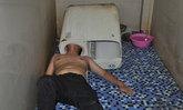 หนุ่มจีนหวิดดับ ซ่อมเครื่องซักผ้าเองแต่พลาดหัวติด