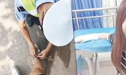 ตำรวจจีนถูกยกย่อง ก้มผูกเชือกรองเท้าให้สาวข้อมือหัก