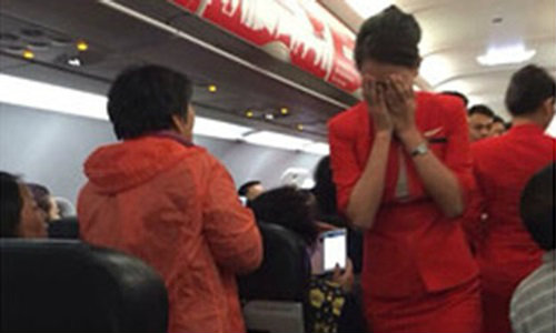 จีนจะลงโทษนักท่องเที่ยวที่ก่อความวุ่นวาย บนเที่ยวบินแอร์เอเชีย