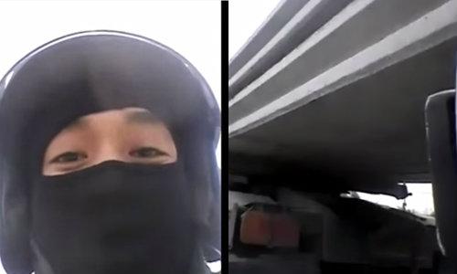 จวกยับ! หนุ่มคะนอง โชว์ซิ่งมอเตอร์ไซค์เข้าใต้รถพ่วง