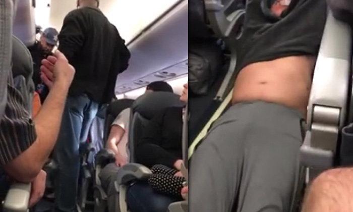 ดังไปทั่วโลก สายการบินดังใช้กำลังฉุดผู้โดยสารลงจากเครื่อง